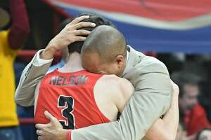 Fairfield's Tyler Nelson gets a hug from head coach Sydney Johnson after he leaves the game before a loss to Iona in the Metro Atlantic Athletic Conference Tournament's championship game at the Times Union Center on March 5.