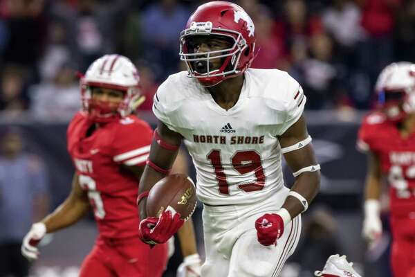 North Shore receiver Shadrach Banks (19) catches a pass for a touchdown in the first half of a Class 6A Div. I Semi-Final high school football playoff game at NRG Stadium on Friday, Nov 30, 2018, in Houston.