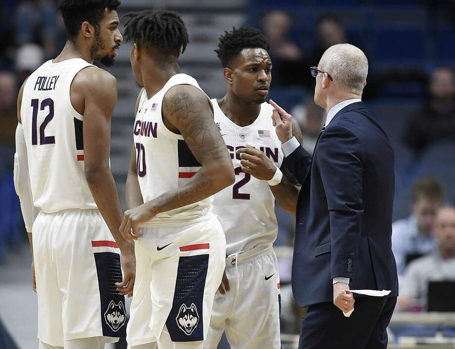 UConn coach Dan Hurley, right, speaks with Tarin Smith (2) during a timeout in a game earlier this season. The Huskies return to action on Saturday against Manhattan. Photo: Jessica Hill / Associated Press / Copyright 2018 The Associated Press. All rights reserved