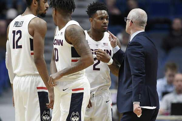UConn coach Dan Hurley, right, speaks with Tarin Smith (2) during a timeout in a game earlier this season. The Huskies return to action on Saturday against Manhattan.