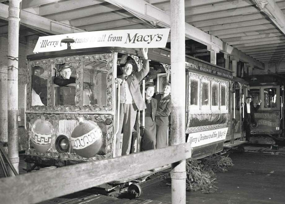 A Macy's-themed cable car stayed in the barn in December 1951 when a holiday celebration was canceled over a lawsuit. Photo: Art Frisch / The Chronicle 1951