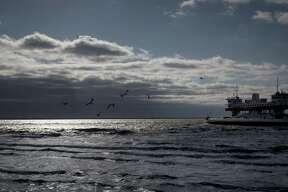 The ferry takes people to Galveston, Friday, Dec. 14, 2018, in Port Bolivar.