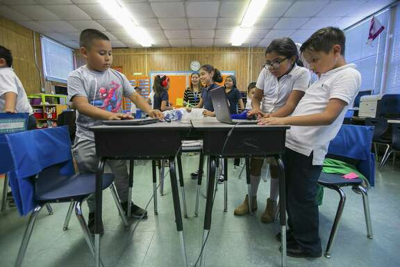 Third graders in Ms. Alvayeros' class at Kelso Elementary School finish an exercise with laptops, Thursday, May 17, 2018, in Houston. According to a draft report released by the Texas Commission on Public School Finance, only four of 10 students met the state's 3rd grade reading standard on 2018 state STAAR exams. ( Mark Mulligan / Houston Chronicle )