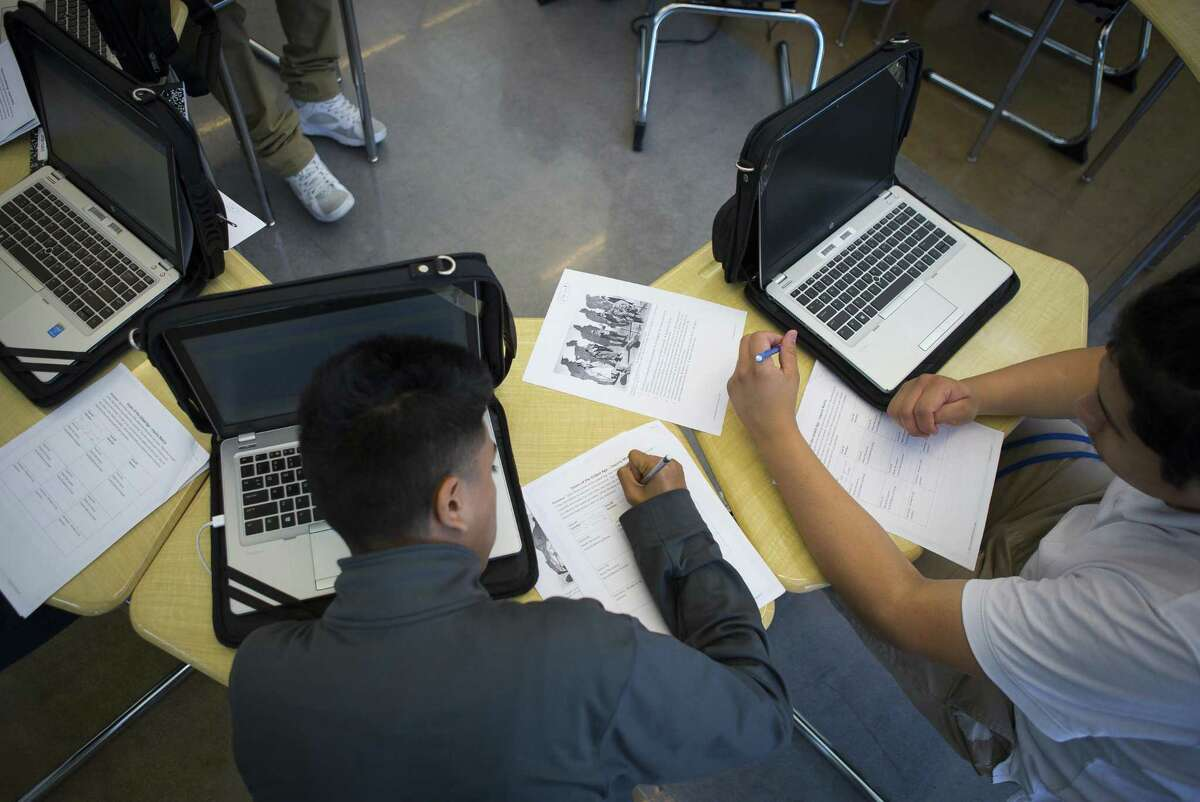 Students all use laptops in their class at Houston Independent School District's Booker T. Washington High School, Wednesday, Sept. 19, 2018 in Houston. The school opened its new building this year and is looking towards the future after experiencing failing test scores and falling enrollment over the last few years.