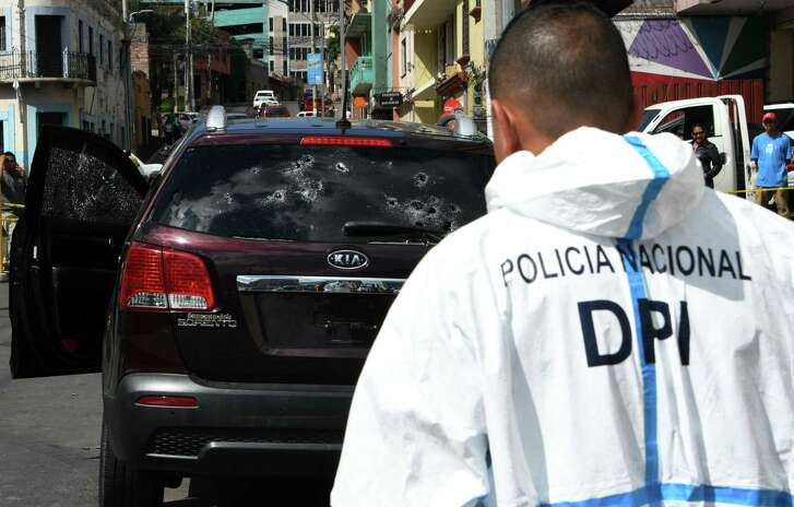 A car riddled with bullets is seen at the crime scene where the man driving the vehicle was shot to death in El Guanacaste neighbourhood in Tegucigalpa, on December 7, 2018. - With a homicide rate of 43 per 100,000 citizens, Honduras is one of the most violent countries in the world. (Photo by Orlando SIERRA / AFP)ORLANDO SIERRA/AFP/Getty Images