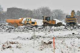 Construction crews work during a snow fall to build the new l-87 exit on Thursday, Dec. 13, 2018 in Colonie, N.Y. (Lori Van Buren/Times Union)