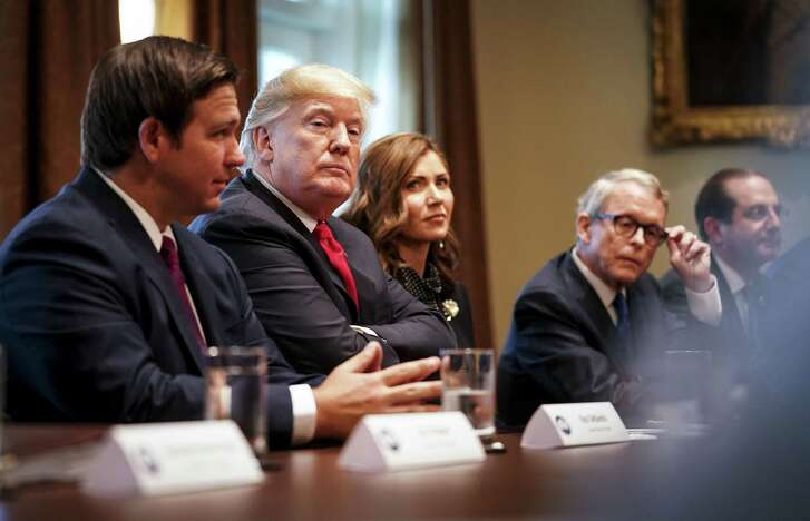 President Donald Trump meets with newly-elected governors at the White House in Washington, Dec. 13, 2018. From left: Ron DeSantis of Florida, Trump, Gretchen Whitmer of Michigan and Mike DeWine of Ohio. (Doug Mills/The New York Times)
