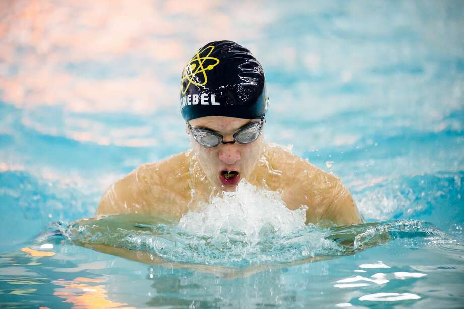 Midland's Nathan Striebel competes in the 100 yard breaststroke during a meet against Grand Blanc on Friday, Dec. 14, 2018 at H. H. Dow High School. (Katy Kildee/kkildee@mdn.net) Photo: (Katy Kildee/kkildee@mdn.net)