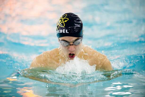 Midland's Nathan Striebel competes in the 100 yard breaststroke during a meet against Grand Blanc on Friday, Dec. 14, 2018 at H. H. Dow High School. (Katy Kildee/kkildee@mdn.net)