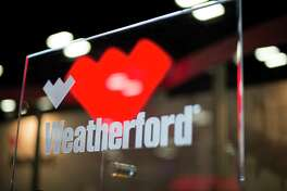 Weatherford International signage is displayed at the DUG Eagle Ford Conference & Exhibition in San Antonio, Texas, U.S., on Monday, Oct. 15, 2012. Marathon Oil Corp., the U.S. oil and natural gas producer that spun off its refining business last year, is seeking to sell more than 96,000 net acres in the Eagle Ford formation in Texas. Photographer: Eddie Seal/Bloomberg