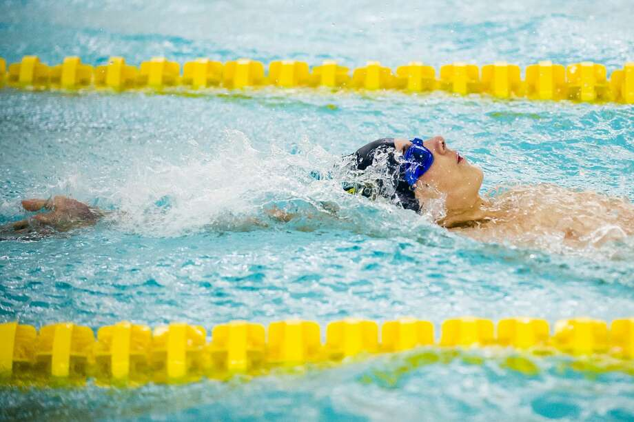 Midland's Lawrence Millward competes in the 100 yard backstroke during a meet against Grand Blanc on Friday, Dec. 14, 2018 at H. H. Dow High School. (Katy Kildee/kkildee@mdn.net) Photo: (Katy Kildee/kkildee@mdn.net)