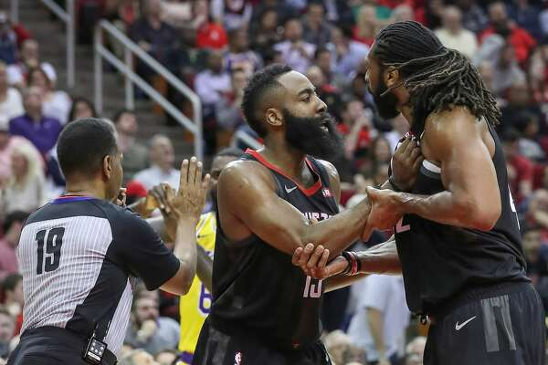 Houston Rockets guard James Harden (13) tries to calm Houston Rockets center Nene Hilario (42) down after a referee called for his second technical foul during the second half of an NBA basketball game at Toyota Center on Thursday, Dec. 13, 2018, in Houston.