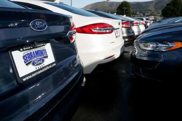 New cars are parked in the lot at the Serramonte Ford dealership in Colma, Calif. on Friday, Dec. 14, 2018. Beginning Jan. 1 auto dealerships will be required to affix temporary license plates to every vehicle sold and before it drives off the lot.