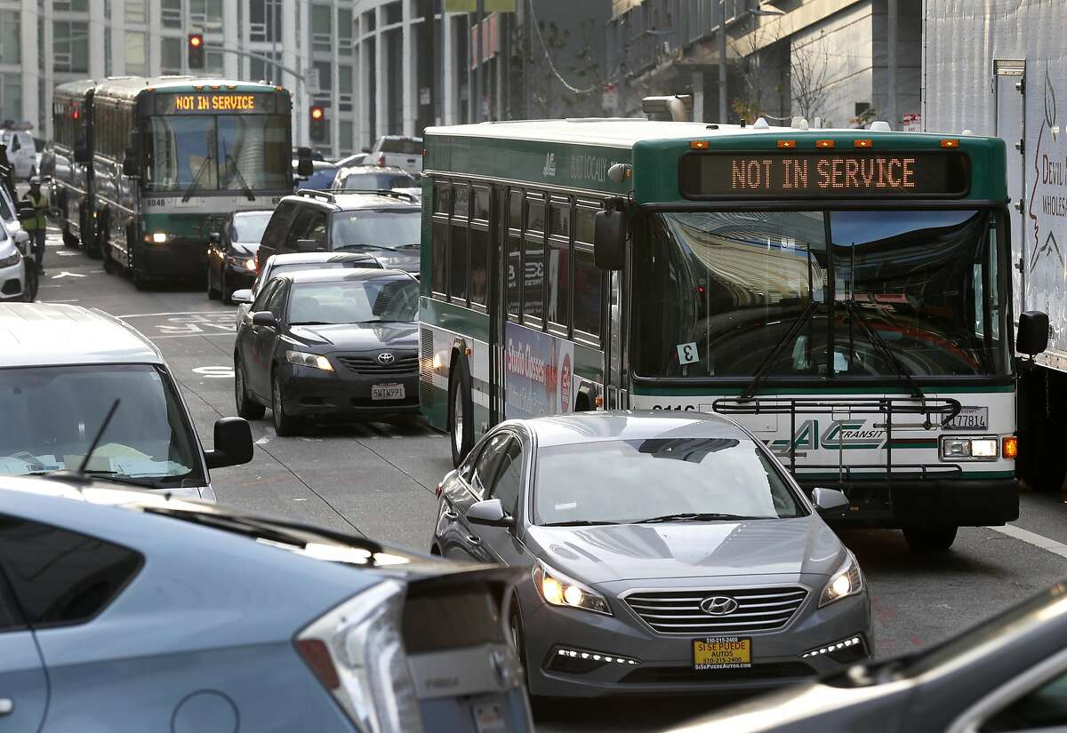 AC Transit buses on Fremont Street make their way through the morning commute to the Temporary Transbay Terminal in San Francisco, Calif. on Wednesday, Dec. 12, 2018. With the extended closure of the new Salesforce Transit Center, buses exiting the Bay Bridge have been forced to navigate clogged city streets adding several minutes to commute times and frustrating passengers.