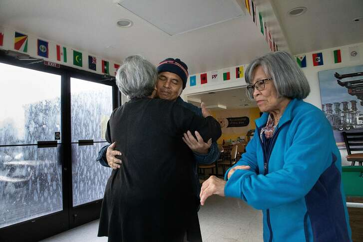 Chaplain Tess Benin hugs Dario Longjas Conde, 52, after a prayer circle along with Sister Alodia Corpuz at the  International Maritime Center on Friday, Dec. 14, 2018, in Oakland, CA.  Longjas Conde is on a ship nine months out of the year.  He says he makes 3 times more money than he would normally in his country.