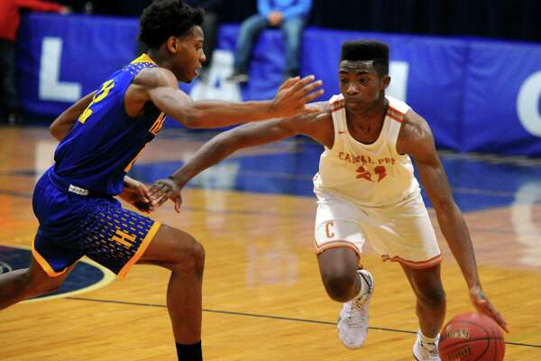Capital Prep's Jeremiah Taylor (21) drives the ball towards the hoop as Harding's Markis Christie (12) defends during basketball tournament action at Notre Dame of Fairfield in Fairfield, Conn., on Friday Dec. 14, 2018.