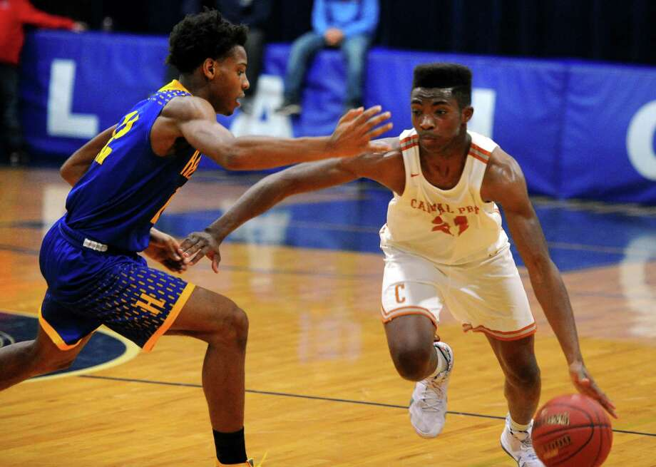 Capital Prep's Jeremiah Taylor (21) drives the ball towards the hoop as Harding's Markis Christie (12) defends during basketball tournament action at Notre Dame of Fairfield in Fairfield, Conn., on Friday Dec. 14, 2018. Photo: Christian Abraham / Hearst Connecticut Media / Connecticut Post