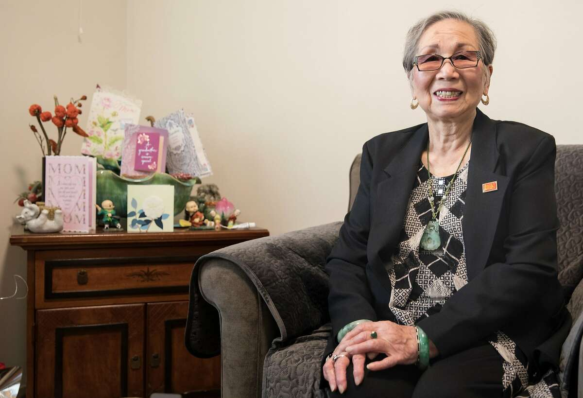 Chang Jok Lee, 92, poses for a portrait inside her newly-renovated apartment at Ping Yuen Center in the Chinatown neighborhood of San Francisco, Calif. Thursday, Nov. 8, 2018.