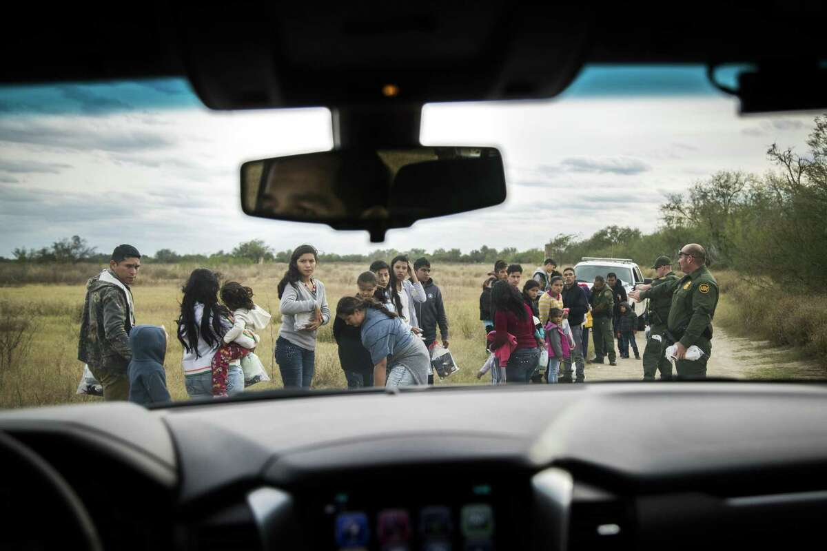 Border Patrol agents process about a dozen mostly Central American families after they turned themselves in near the Rio Grande River on Tuesday near Peñitas, Dec. 11, 2018.