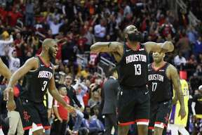 After posterizing LeBron James, James Harden (13) kept the crowd in a frenzy during the Rockets' 126-111 victory over the Lakers on Thursday night. Harden scored 50 points as part of a triple-double.