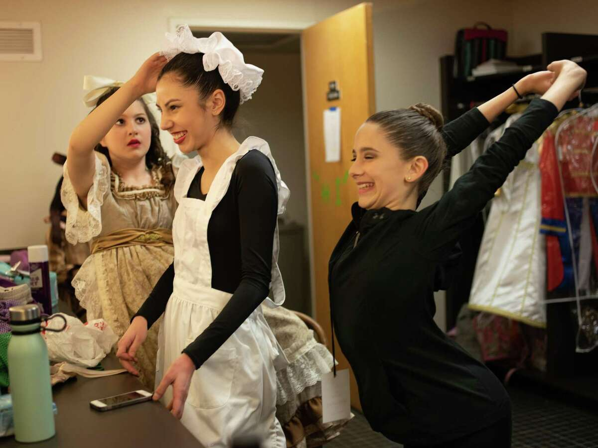 Faith Ruth, second left, and Gigi Gilbert, right, ready themselves in the dressing room during a dress rehearsal of the San Antonio Youth Ballet performing The Nutcracker ballet with the South Texas Symphonic Orchestra at the Carver Cultural Community Center on Thursday, December 13, 2018.