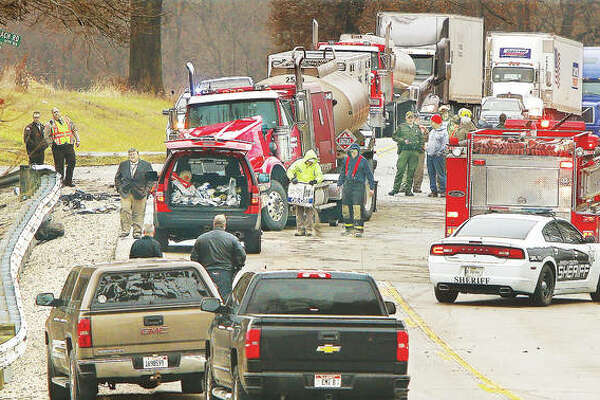 Jersey County Sheriff's deputies, Illinois State Police and Jerseyville firefighters were among those on the scene of a serious head-on crash Friday on U.S. Route 67 at Stagecoach Road in Jersey County. According to Illinois State Police, at least one person was seriously injured in the head-on crash, which involved a semi-truck. The truck, center, was carrying a U.S. Department of Transportation placard indicating it carried gasoline. U.S. Route 67 was closed for hours, with police blocking it at Delhi Road to the south and Crystal Lake Road to the north. The front wheel of the semi was bent inward and car parts, including a wheel, were strewn all over the roadway. Other semi-trucks, which could not turn around, background, waited patiently for the scene to be cleared Friday afternoon.