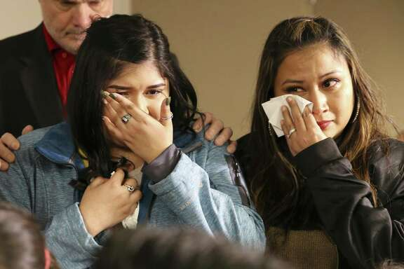 Eliza Martinez (center) and her mother, Desiree Martinez, wipe away tears after meeting the woman who received their loved one's liver.
