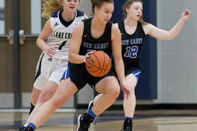 New Caney power forward Abigail Lynch, seen here earlier this week against Lake Creek, scored 17 points in a win over Kingwood Park Friday night.