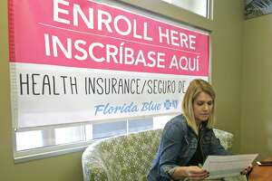 Catherine Reviati reviews the different Affordable Care Act enrollment options, Thursday, Nov. 2, 2017, in Hialeah, Fla. Health care advocacy groups are making an against-all-odds effort to sign people up despite confusion and hostility fostered by Republicans opposed to former President Barack Obama's signature domestic policy achievement. (AP Photo/Alan Diaz)