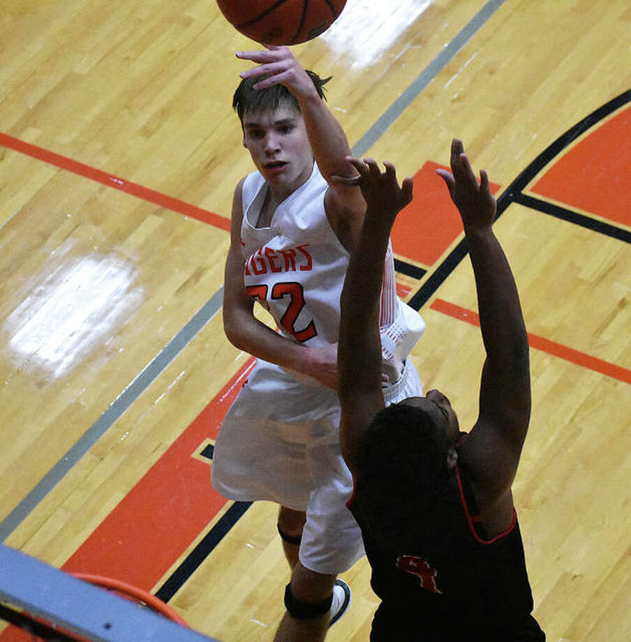 Edwardsville sophomore Brennan Weller attempts to hit a turnaround shot just before the end of the second quarter against Granite City. Weller finished with a career-high 23 points.