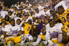Mary Hardin-Baylor reacts after defeating Mount Union 24-16 to win the Stagg Bowl NCAA Division III college football championship at Woodforest Bank Stadium, Friday, Dec. 14, 2018, in Shenandoah.