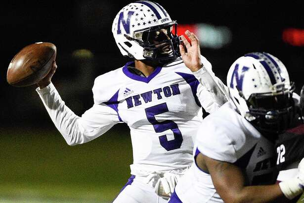 Newton quarterback Josh Foster (5) throws a pass during the second half of a 3A State semi-final high school football playoff game against East Bernard, Friday, Dec. 14, 2018, in New Caney, TX. Newton won the game 21-14.