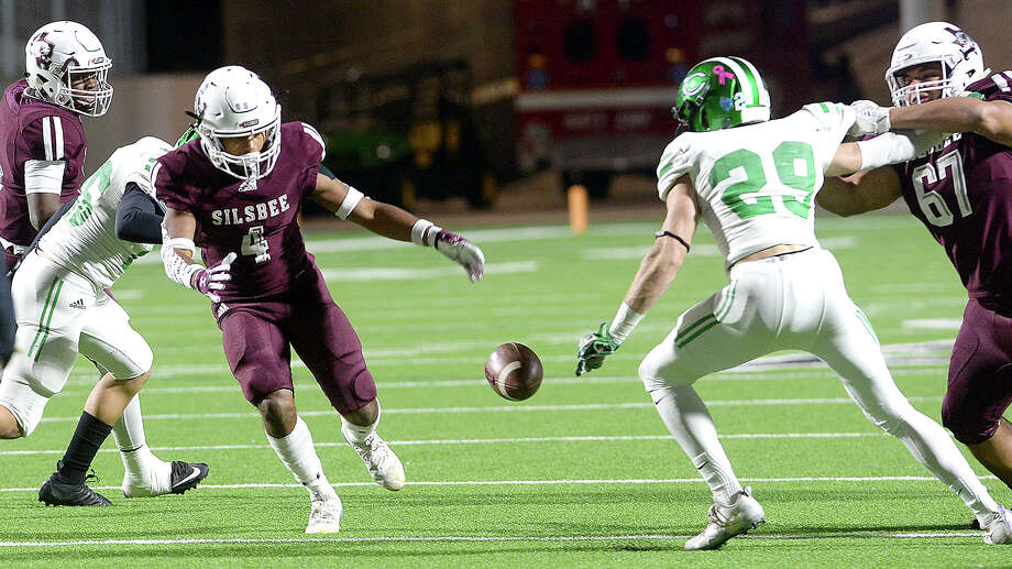 Silsbee's Dralyn Tasyl;or looks to recover the loose ball as Cuero's Justin Ficklen moves in during the Class 4A Div. II state semifinals at Legacy Stadium.