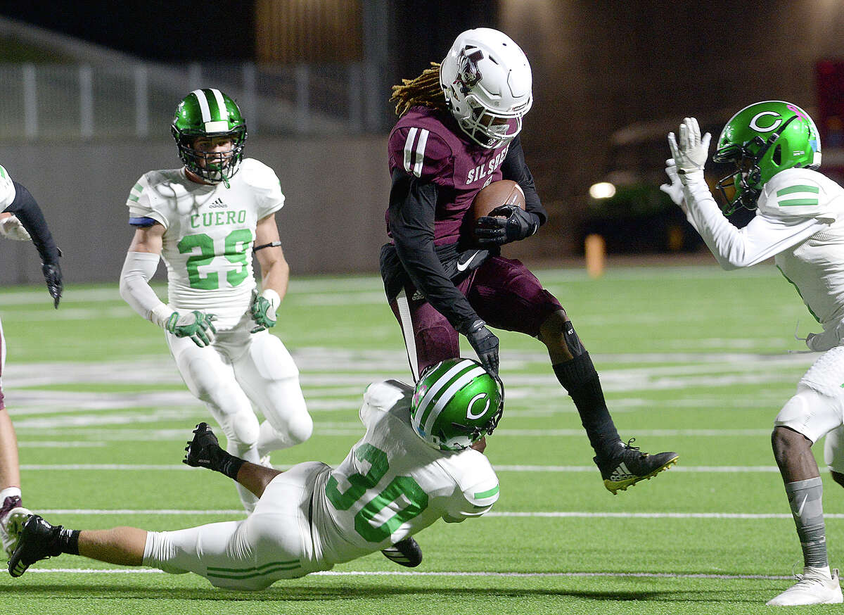Silsbee's Darshon Turk tries to break over the tackle by Cuero's Austin Schwarz during the Class 4A Div. II state semifinals at Legacy Stadium. Photo taken Friday, December 14, 2018 Kim Brent/The Enterprise