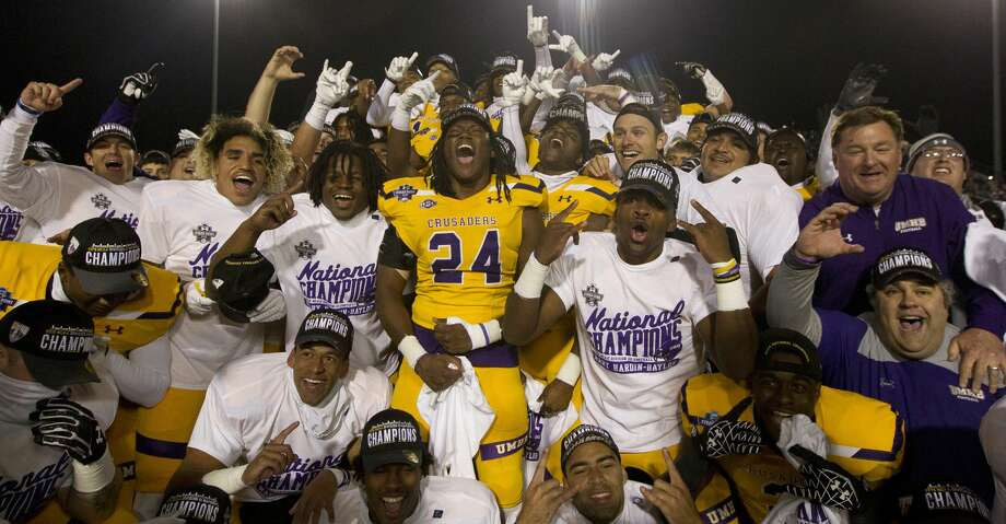 Mary Hardin-Baylor players react after defeating Mount Union 24-16 to win the Stagg Bowl NCAA Division III college football championship at Woodforest Bank Stadium, Friday, Dec. 14, 2018, in Shenandoah. Photo: Jason Fochtman/Staff Photographer