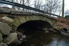 The bridge spanning Keeler Brook on Rowayton Ave. Friday, December 14, 2018, in Norwalk, Conn. Roughly half of the 26 Norwalk bridges measuring 20 feet or less in length were deemed as being as in ?'fair or worse?' shaped based upon a 2016 Connecticut Department of Transportation report. The bridges span everything from culvert pipes to streams. With the DOT no longer inspecting such small bridges, the Norwalk Common Council on Tuesday evening authorized the city?'s Department of Public Works to hire Freeman Companies, at a cost not to exceed $251,200, to evaluate the 26 bridges.