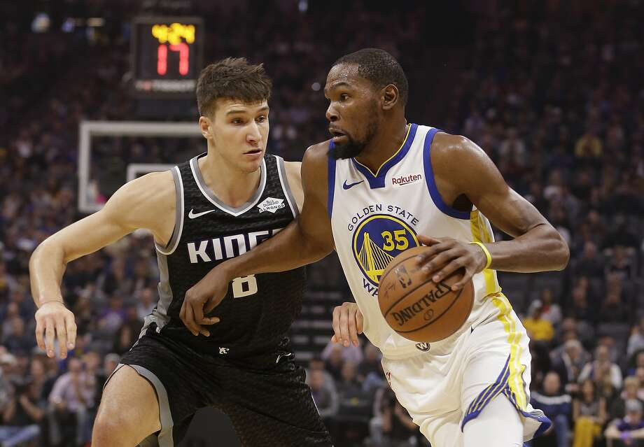 Golden State Warriors forward Kevin Durant, right, drives to the basket against Sacramento Kings guard Bogdan Bogdanovic 2during the first half of an NBA basketball game Friday, Dec. 14, 2018, in Sacramento, Calif. (AP Photo/Rich Pedroncelli) Photo: Rich Pedroncelli / Associated Press