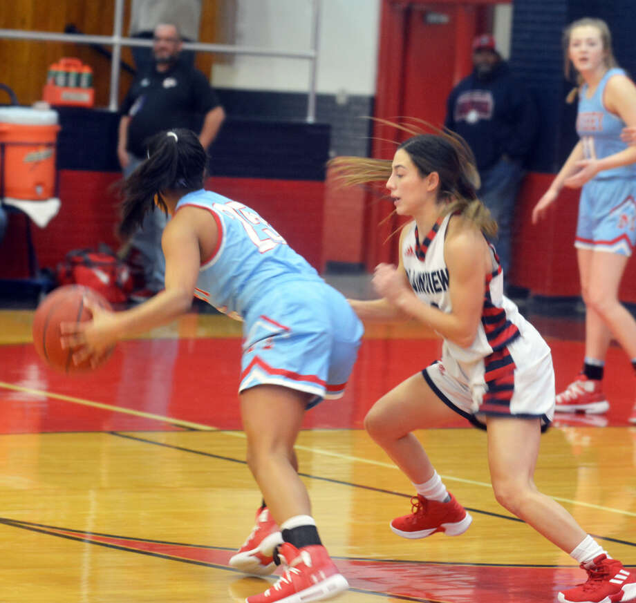 Plainview senior guard Julissa Chavez defends Monterey junior point guard Alyssa Trevino (25) during District 3-5A girls basketball action on Friday at Bulldogs Gym in Plainview. Photo: Alexis Cubit/Plainview Herald