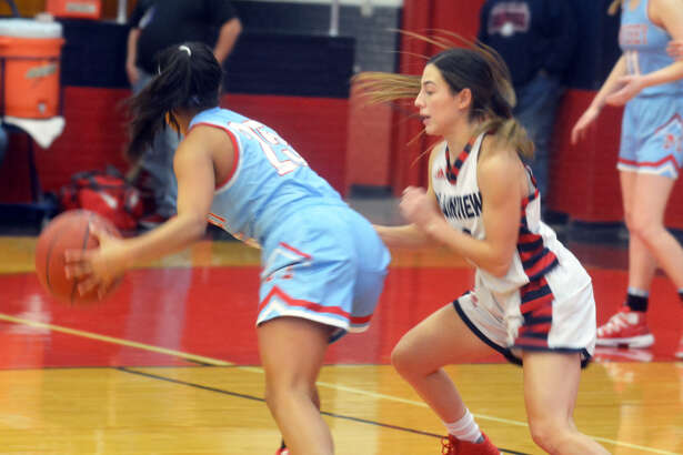 Plainview senior guard Julissa Chavez defends Monterey junior point guard Alyssa Trevino (25) during District 3-5A girls basketball action on Friday at Bulldogs Gym in Plainview.