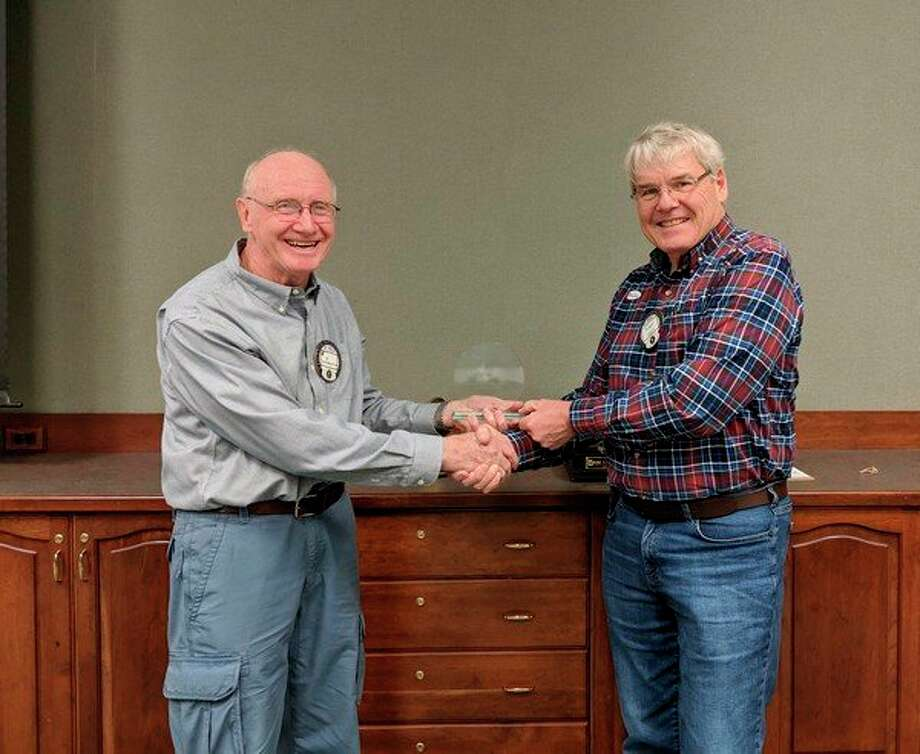 Al Burmester recently accepted an Eagle Village Recognition Award from Kiwassee President Roger Moll on behalf of the many Kiwassee volunteers. (Photo provided)