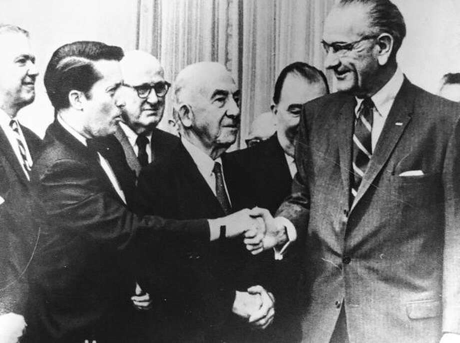 "Kenneth J. Gray, ""the Prince of Pork,"" shakes hands with Lyndon B. Johnson, known for his wheeling and dealing in the U.S. Senate. Photo: Photo Courtesy Of Marleis Trover/Maxine Pyle"