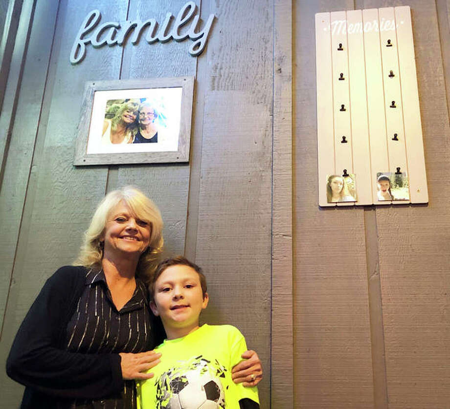The Back Bar owner Marion Gilson stands with her grandson, Zach, at the business's soft opening earlier this month. The business is located at 228 N. Main St. Gilson's mother died two years ago, pictured in the framed photo, and believes she has continuously motivated her through all the ups and downs of opening a business. Photo: Brittany Johnson | The Intelligencer