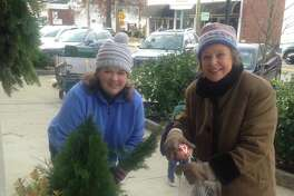 Old Greenwich Garden Club members Wendy Yu and Mary Bishop were among the many club volunteers who recently went out onto Sound Beach Avenue in Old Greenwich to decorate the main business district of the village with festive holiday touches, continuing a tradition in town.