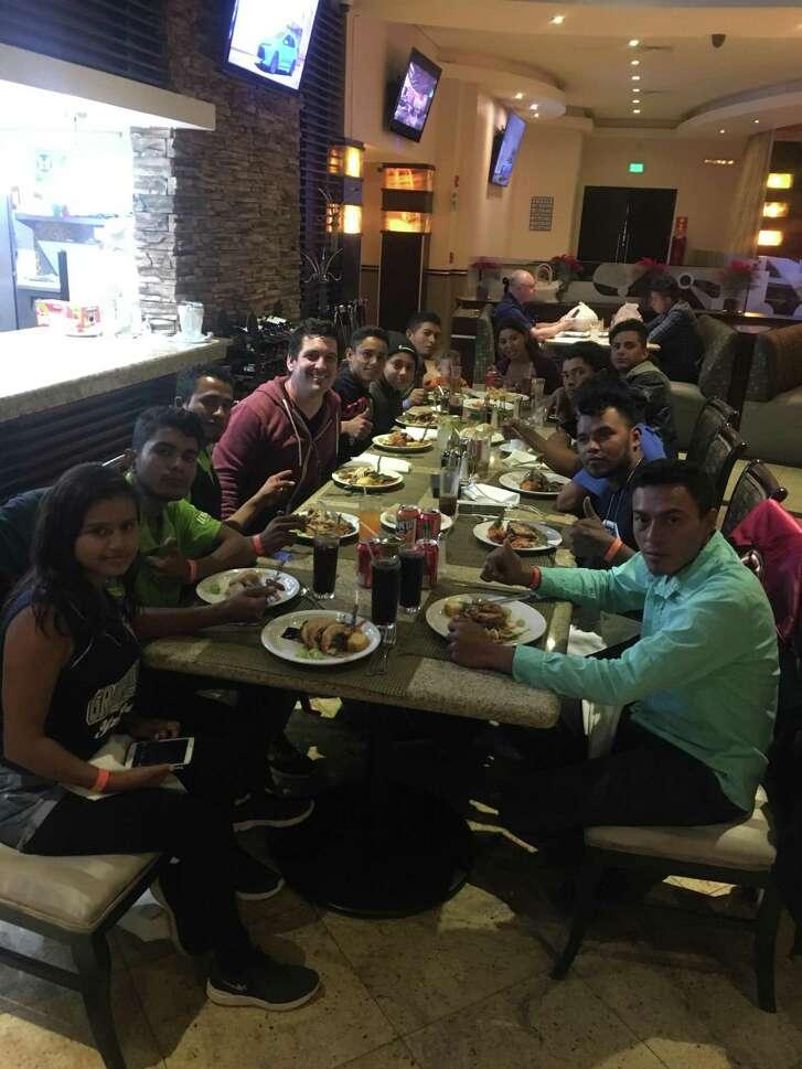 "San Antonio clergyman Gavin Rogers celebrated Thanksgiving with his ""migrant caravan"" family in a Tijuana restaurant."