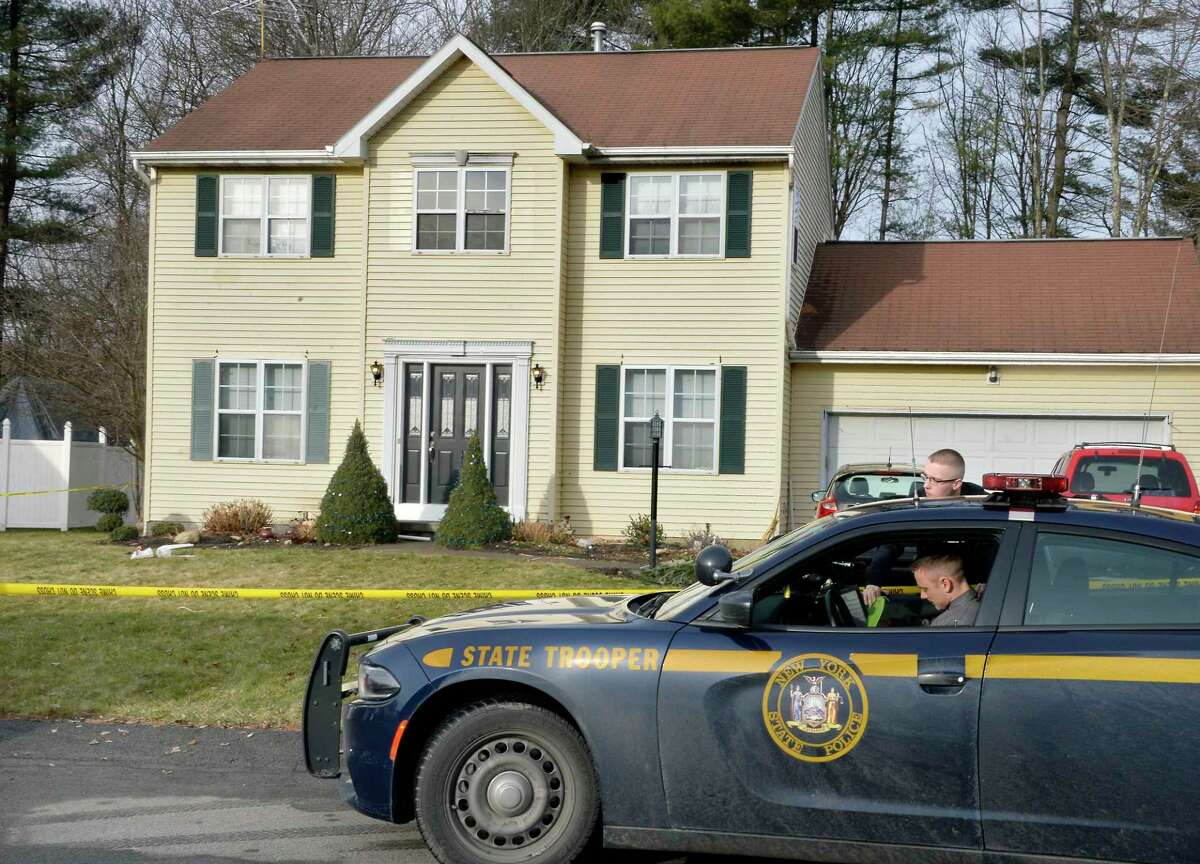 Police remain on the scene at 723 Adams Circle Saturday Dec. 15, 2018 in Ballston Spa, NY. Three bodies were discovered inside the single-family home on Friday. (John Carl D'Annibale/Times Union)