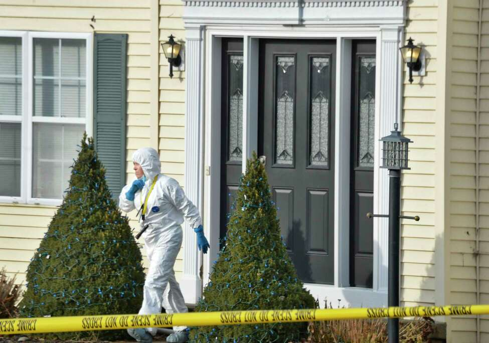 A technician at 723 Adams Circle Saturday Dec. 15, 2018 in Ballston Spa, NY. Three bodies were discovered inside the single-family home on Friday. (John Carl D'Annibale/Times Union)