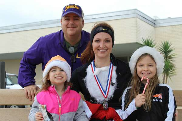The Pollet Family at the second annual Santa Run hosted by CASA at the Jack Brooks Regional Airport.