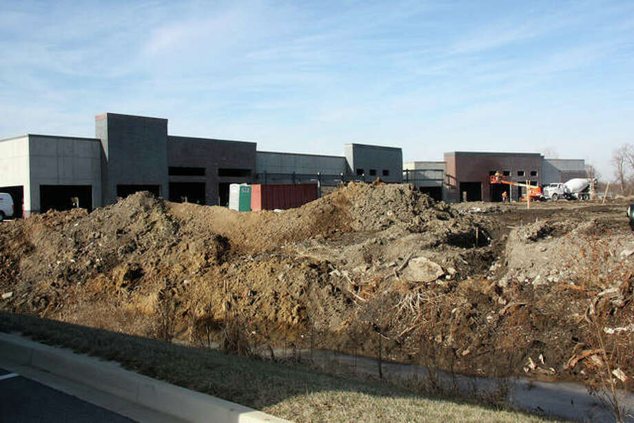 Brick buildings rise from the earth along Plum Street as the IronWorks development takes shape immediately north of First to the Finish in Edwardsville, as part of a project to be completed by April 2019, according to the city's economic development director. Photo: Charles Bolinger | The Intelligencer
