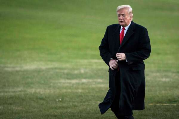 President Donald Trump walks across the South Lawn of the White House on Dec. 7. A person familiar with his schedule said Trump spent more time than usual in his official residence this week.