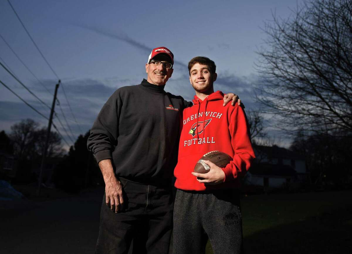 Larry DeLuca and his son, L.J. DeLuca, at their home in Cos Cob. L.J. played linebacker on Greenwich High School's 2018 undefeated team and his father Larry played defensive end on the 1983 undefeated team.
